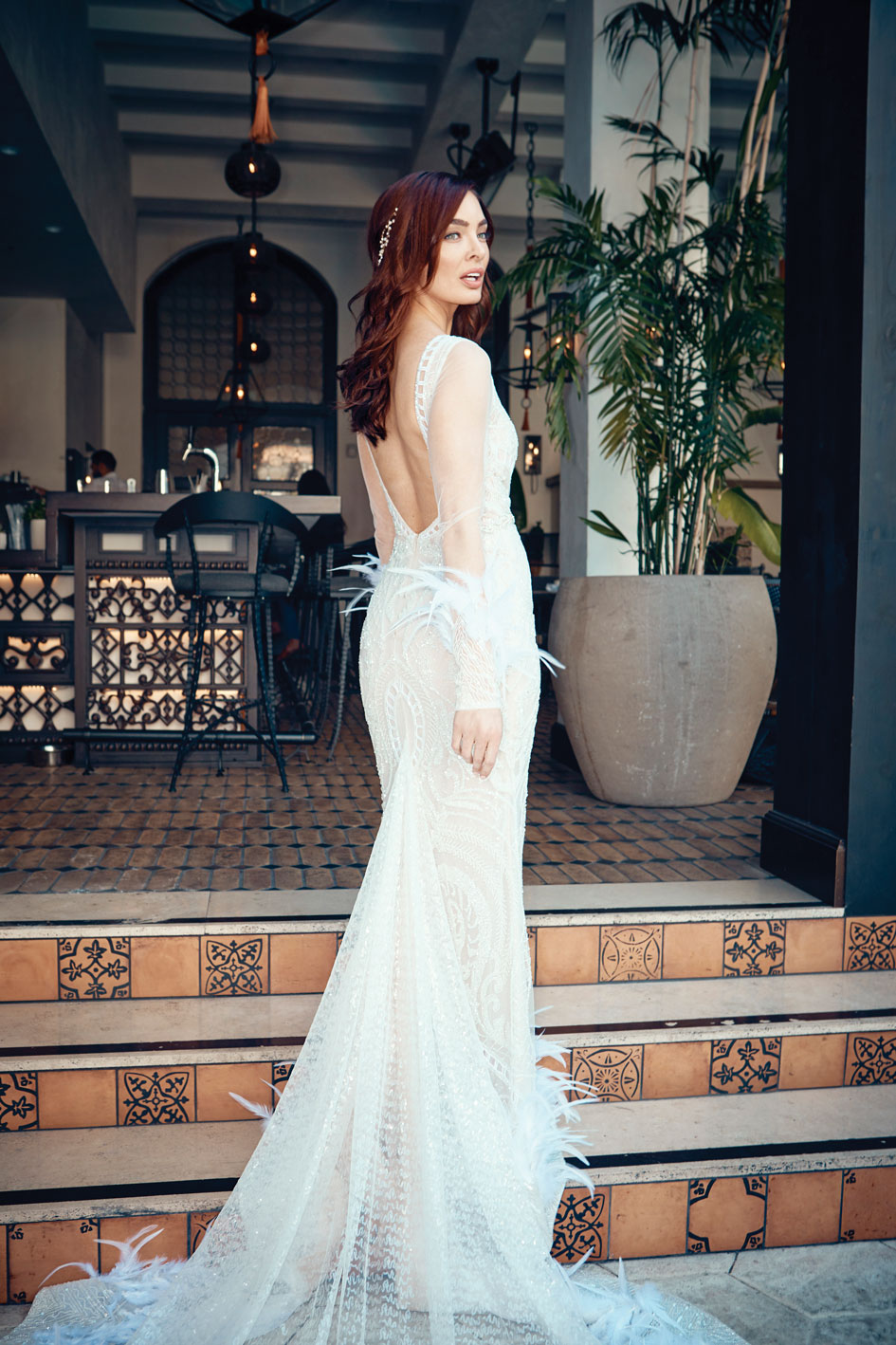 323dadc961ff99 Berta bridal gown featuring a beaded plunging neck line with feather  details at the arm and hem, $12,870, from Lovella Bridal in Glendale.