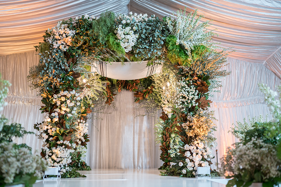 A floral arch at Neda and Michael's wedding at Four Seasons Westlake Village