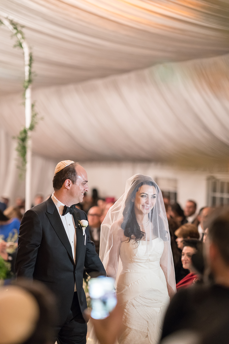 Michael and Neda walk down the aisle at their wedding at Four Seasons Westlake Village