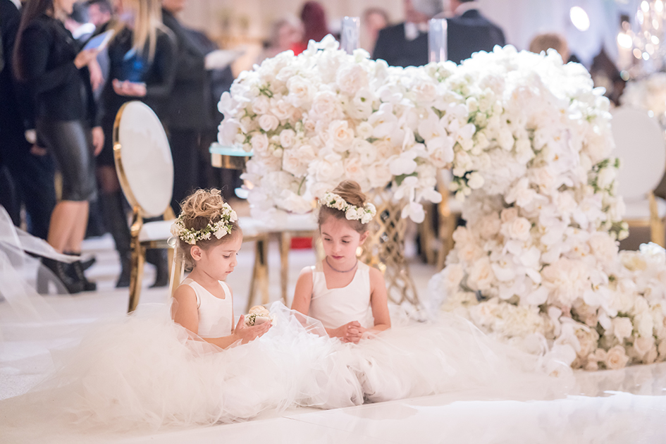 The flower girls take a rest at Michael and Neda's wedding at Four Seasons Westlake Village