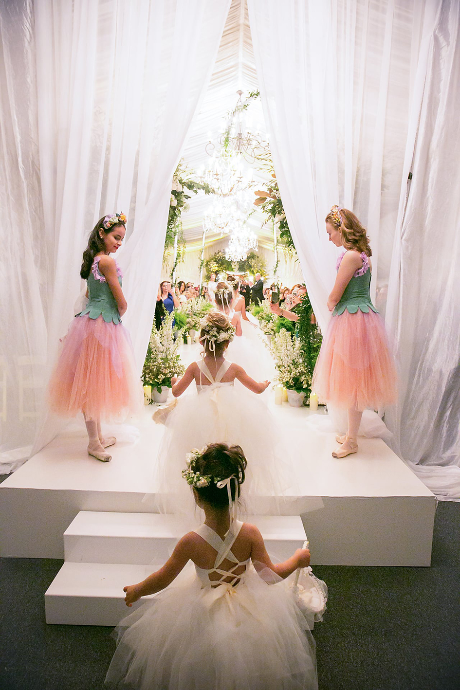 The flower girls walk down the aisle at Michael and Neda's wedding at Four Seasons Westlake Village