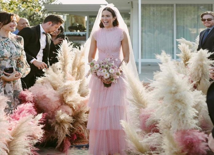 To get Mandy Moore's wedding look, designer Azazie features a similar dress at half the price.
