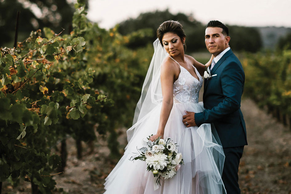 Soft pastels and a perfect wedding gown set the stage for a dreamy vineyard wedding