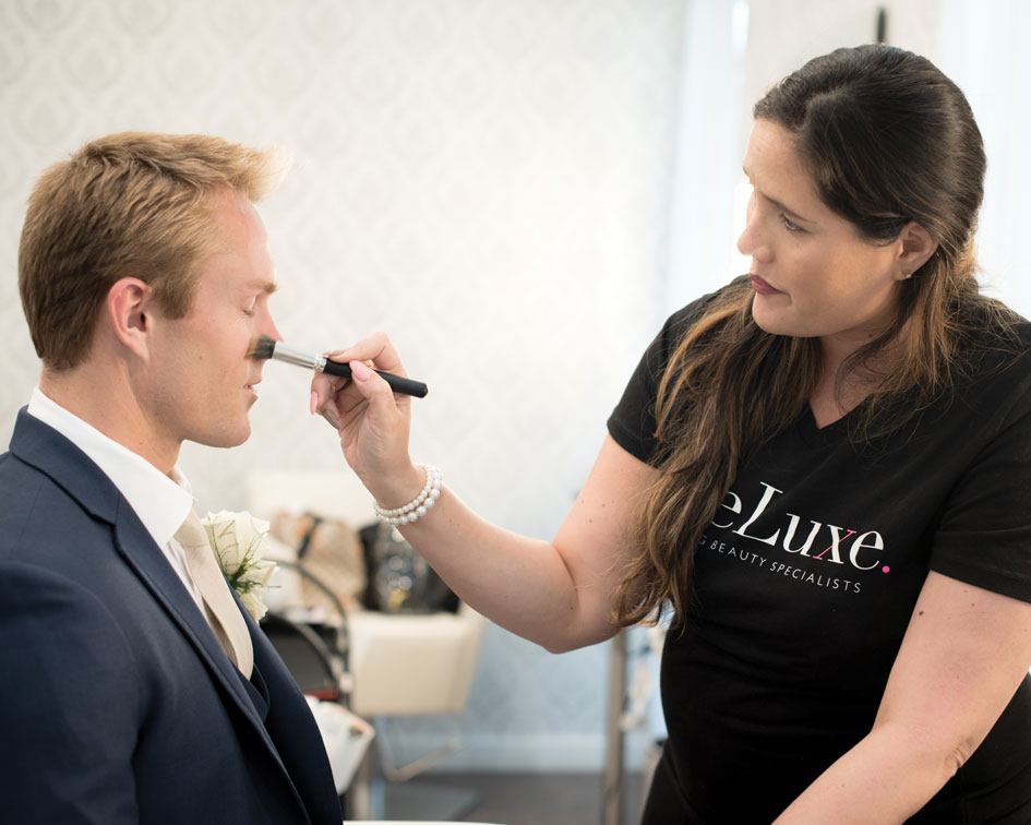 A groom gets a taste of wedding day pampering from the team at BreLuxe Beauty.