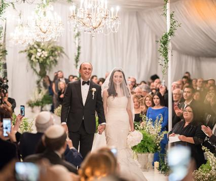 Michael and Neda walk down the aisle at their wedding at Four Seasons Westlake Village wedding.