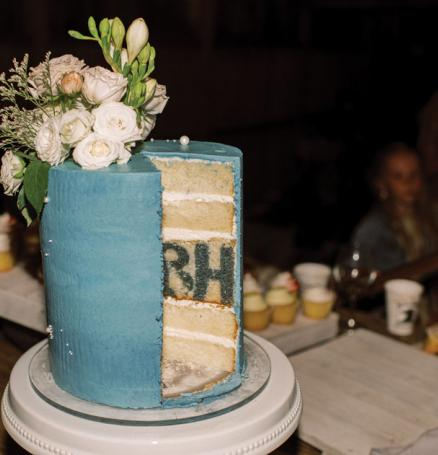 The bride and groom's initials are revealed when this wedding cake is cut open.