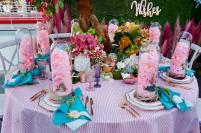 Bluebell Events and The Hidden Garden created a magical setting with shades of blues and pinks, evoking a tropical theme with the Oodle linen in Candy Floss and the Mermaid Iridescence napkins.