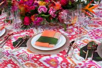 Fiesta in Tulum by Michelle Garibay and Florals by Isabelle transports you to Mexico with its vibrant Ikat Marmalade linens and Naranja Almafi napkins.